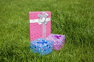 gift boxes on a green grass, green, gift, box, surprise