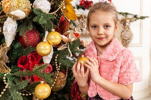 girl holding a Christmas toy