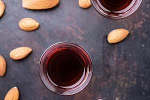 Almond liquor amaretto on a grunge black table