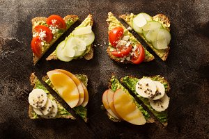 Avocado toast with various toppings