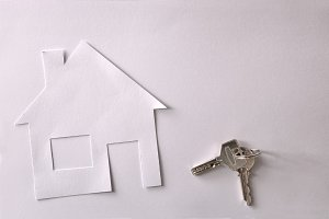 Concept of house in paper with keys