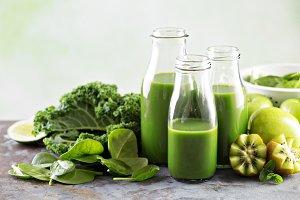 Green juice in glass bottles