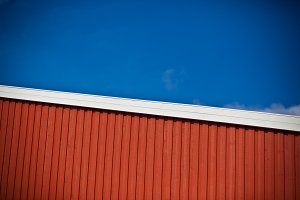 House wall on bright blue sky