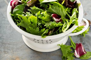 Spring mix salad leaves in a collander
