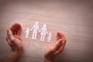 Concept of family protection hands