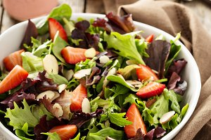 Healthy and colorful salad with spring mix greens