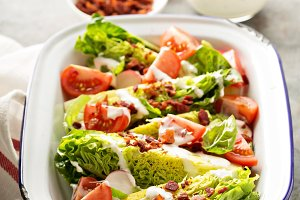 Wedge salad with baby lettuce and tomatoes