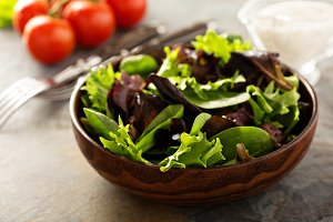 Fresh salad leaves in wooden bowl