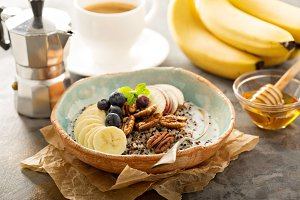 Quinoa porridge with banana, blueberry and pecan nuts