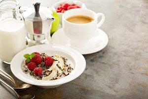 Quinoa porridge with raspberry and coconut flakes