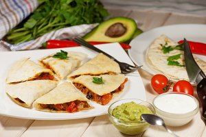 Quesadilla with chicken, served with guacamole or salsa sauce