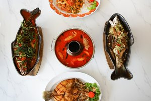 Top view of Thai Asian seafood dishes on white table