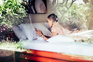 Beauty woman using smartphone in bed
