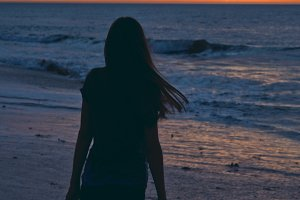 Silhouette of a girl at a beach