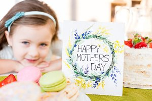 Girl with Mother's day greeting card