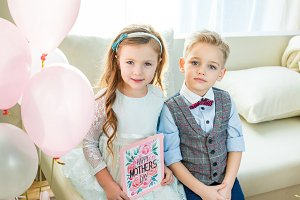 Kids with Happy Mother's Day card