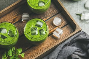 Fresh green smoothie with ice cubes