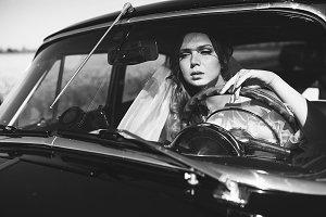 Pretty bride in the car