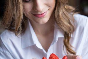 Woman holding strawberry cake