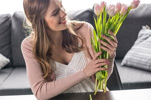 Woman with bouquet of fresh tulips