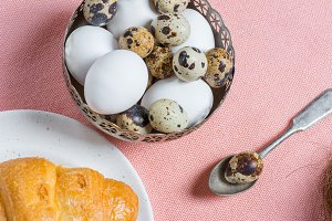 Chicken and quail eggs in bowl