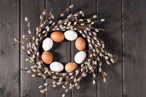 Chicken eggs in catkins wreath