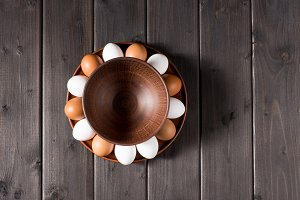 Chicken eggs in brown plate