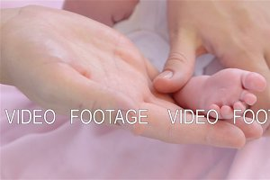 Foot massage newborn baby