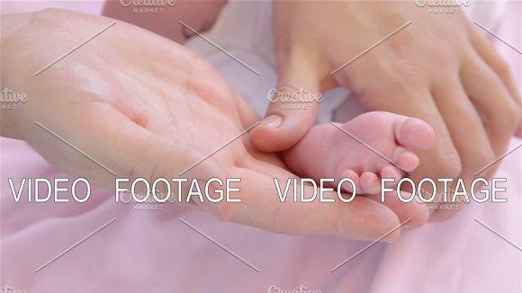 Foot massage newborn baby in Graphics