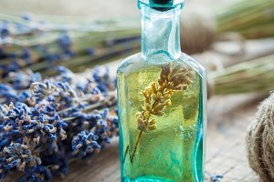 Bottle of essential oil and lavender