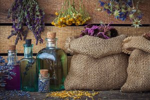 Healing herbs in bags and tincture
