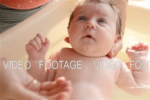 Bathing newborn baby