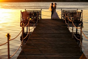 On a wooden bridge over the sea