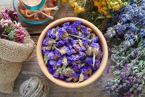 Medicinal herbs, mortar and bag.