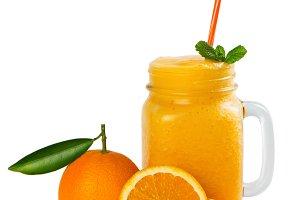 Jar mug with orange smoothie.