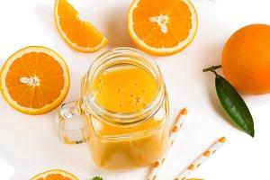 Slices of orange fruit and smoothie.
