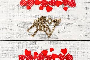 Red hearts golden keys Love