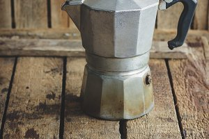 Metal coffeepot on the wooden table
