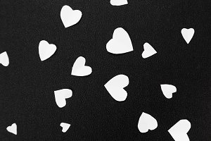 Happy Valentine's Day card with white hearts on a black background.