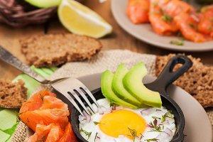 Fried egg, avocado and salmon