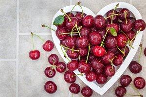 Fresh cherry in a heart