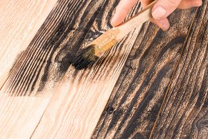 painting wooden board paint brush in black color