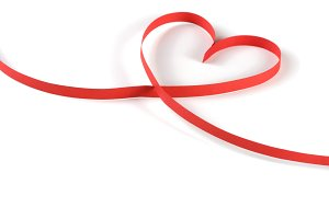 heart made of red paper ribbon isolated on white background