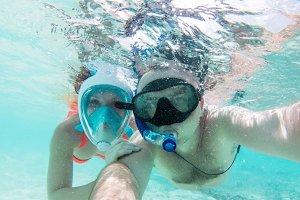 A couple in love taking selfie underwater in Indian Ocean, Maldives