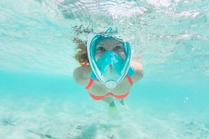 Woman snorkeling underwater in Indian Ocean, Maldives