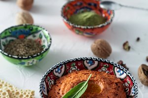 Muhammara dip of sweet peppers with walnuts, cumin, garlic and olive oil.