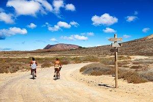 Two girls riding in La Graciosa.
