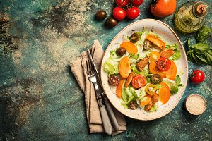 Fresh salad with persimmon