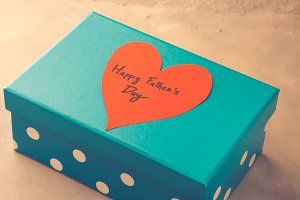 Blue box present for Father's day with red heart. Toned