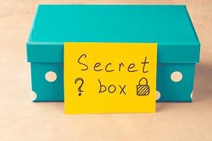 Blue present with paper card written Secret box